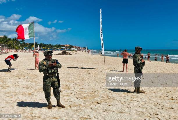 Mexican marines patrol the beach of Playacar near the seaside tourist resort of Playa del Carmen Quintana Roo State on February 14 2019 Playa del...