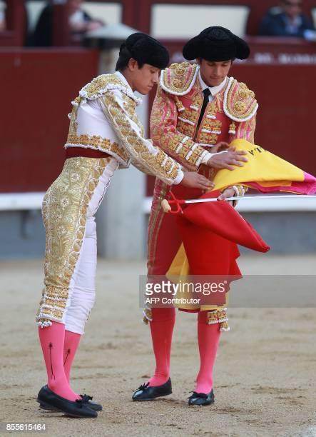 Mexican matador Luis David Adame takes his 'alternativa' beside French matador Sebastian Castella during the Fall bullfighting festival at Las Ventas...