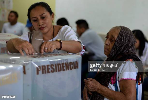 A Mexican Mayan woman casts her vote during the general elections in Hunuku Yucatan State Mexico on July 1 2018 Sick of endemic corruption and...