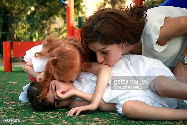 Mexican Mayela Benavides mother of Graciela Elizalde and Valentina Elizalde play in a park in the Guadalupe municipality near Monterrey on September...