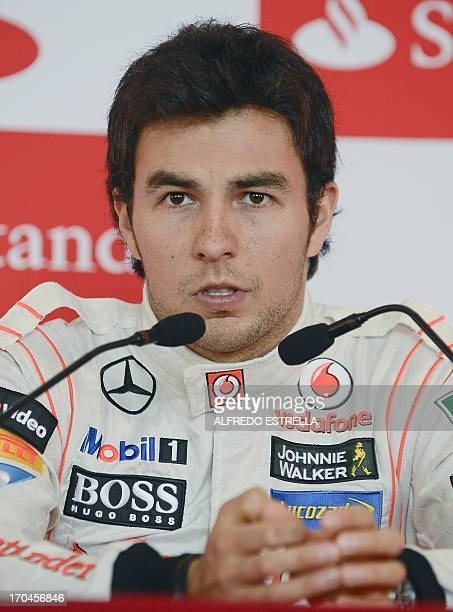 Mexican McLaren F1 driver Sergio Perez speaks during a press conference at a hotel in Mexico City on June 13, 2013. Perez is in Mexico to sign an...