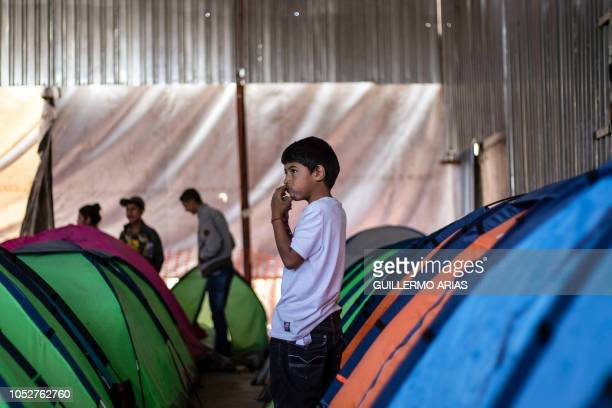A Mexican migrant boy remains next to tents at a shelter in Tijuana Baja California state Mexico in the border with the US on October 22 2018 US...