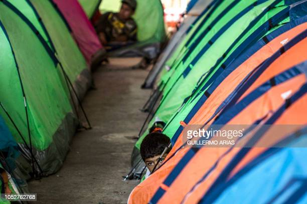 Mexican migrant boy remains next to tents at a shelter in Tijuana Baja California state Mexico in the border with the US on October 22 2018 US...