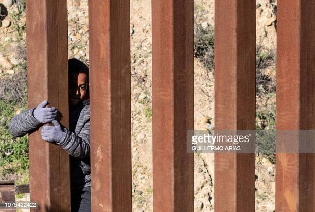 TOPSHOT Mexican migrant child Kevin Andres from Guerrero state crosses the USMexico border fence from Tijuana to San Diego County in the US as seen...