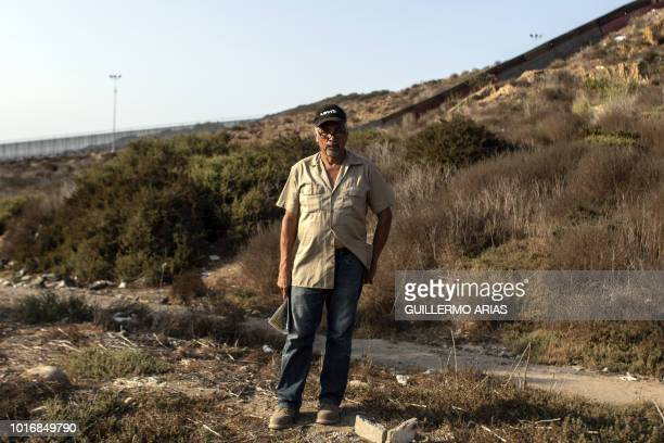 Mexican migrant deported from the US Angel Ayala is pictured at the Smugglers Glutch near the US/Mexico border in Tijuana Baja California state...