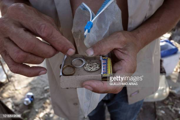 Mexican migrant deported from the US Angel Ayala shows his most valuable items at the Smugglers Glutch near the US/Mexico border in Tijuana Baja...