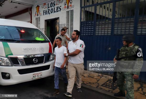 Mexican migrations officers and members of the National Guard detain Central American migrants during an operation at a bar in Tapachula Chiapas...