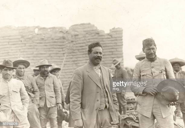 Mexican military commander Pancho Villa stands with his men late 1910s