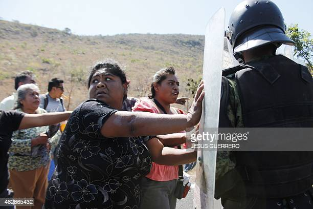Mexican military police from a paratrooper battalion in riot gear clash with farmers who blocked the federal ChilpancingoAcapulco highway on February...