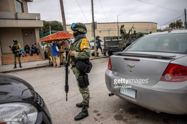 Mexican military police stand guard outside a migrant camp at the U.S. Mexico border on February 22, 2021 in Matamoros, Mexico. U.S. Immigration...