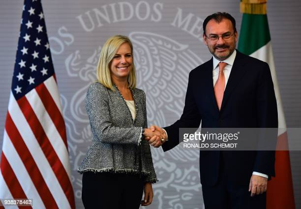 Mexican Minister of Foreign Affairs Luis Videgaray shakes hands with US Secretary of Homeland Security Kirstjen Nielsen in Mexico City on March 26,...