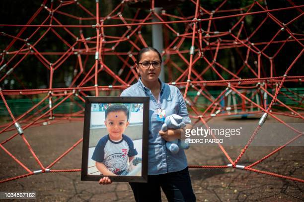 Mexican Miriam Rodriguez Guise holds the portrait of her sevenyearold son Jose Eduardo who died in the September 19 2017 earthquake on September 4...