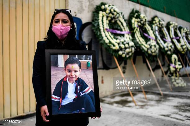 Mexican Miriam Rodriguez Guise holds the portrait of her seven-year-old Jose Eduardo, who died in the September 19, 2017 earthquake, on the third...