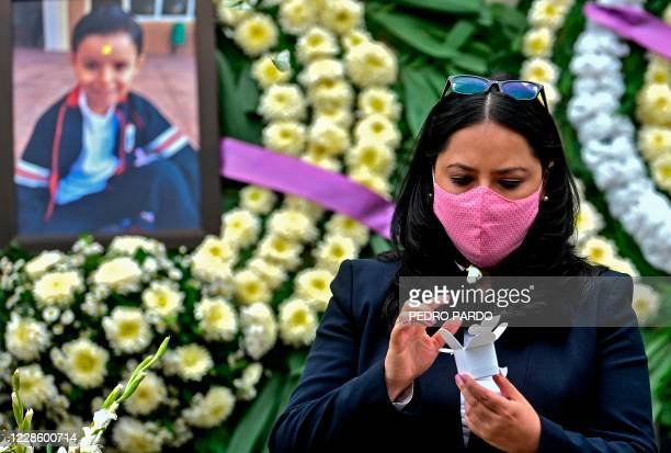 Mexican Miriam Rodriguez Guise, mother of seven-year-old Jose Eduardo, who died in the September 19, 2017 earthquake, releases a butterfly on the...