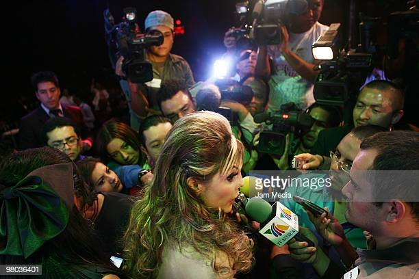 Mexican model Carmen Campuzano speaks to the press as she arrives for the fashion show of Mexican designer Artemiza Cruz for La Vill on March 24 2010...