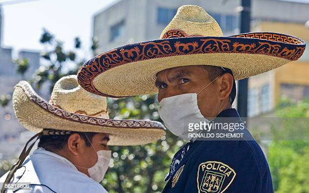 Mexican mounted police stand guard wearing surgery masks at Alameda Square in Mexico City on May 1 2009 Few people can be seen in the almost empty...