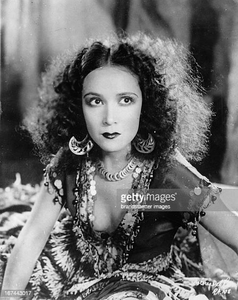 """Mexican movie star Dolores del Rio in the movie """"Revenge"""". Photograph. 1928 Der mexikanische Filmstar Dolores del Rio im Film """"Revenge"""". 1928...."""