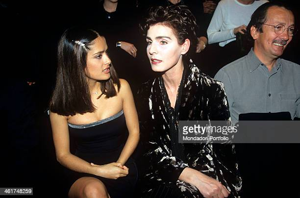 Mexican movie star Salma Hayek among the guests of honor at the Milan Fashion Week sits next to Antonia Dell'Atte to attend the fashion show of...
