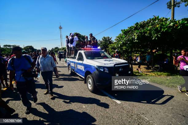 A Mexican Municipal Police truck carries members of Human Rights organizations as Honduran migrants take part in a caravan heading to the US on the...