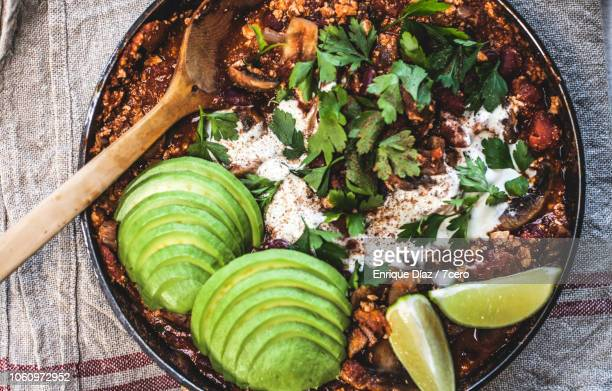 mexican mushroom, tofu chilli pot to share with avocado - meat substitute stock pictures, royalty-free photos & images