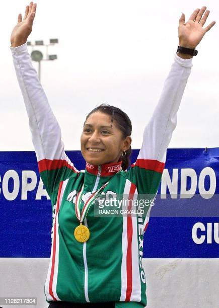 Mexican Nancy Contreras celebrates her gold medal during the fourth stage of the World Cycling Competition in Mexico City on August 12 2001 La...