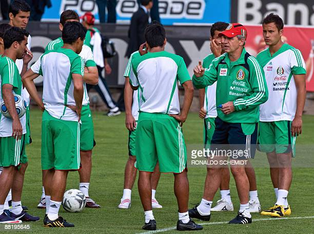 Mexican national football team coach Javier Aguirre gives instructions to his players during a training session on June 3 2009 in Mexico City Mexico...