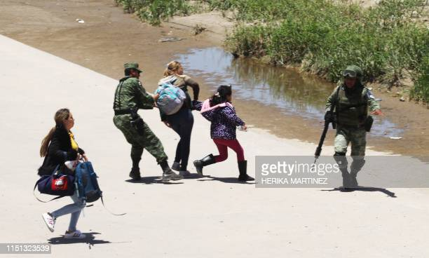 TOPSHOT Mexican National Guard members prevent Central American migrants from crossing the Rio Bravo in Ciudad Juarez State of Chihuahua on June 21...