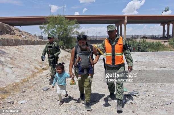 Mexican National Guard members prevent Central American migrants from crossing the Rio Bravo to the US in Ciudad Juarez State of Chihuahua Mexico on...