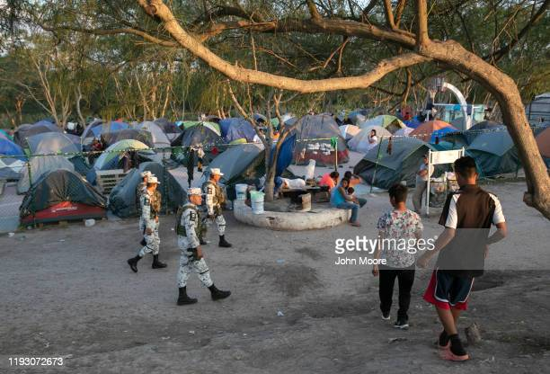 Mexican National Guard troops patrol through a camp for asylum seekers on December 08 2019 in the border town of Matamoros Mexico More than 1000...