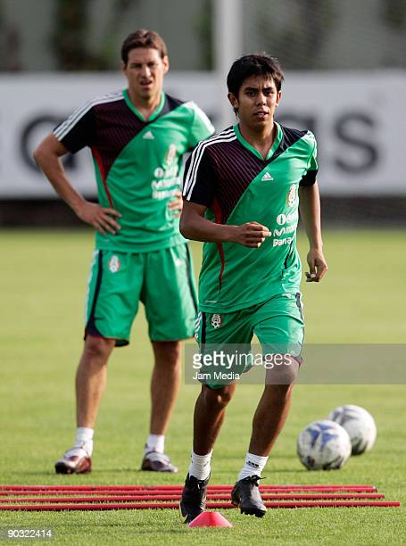 Mexican national soccer team players Guillermo Franco and Nestor Calderon work out during a training session at the Mexican Football Federation's...