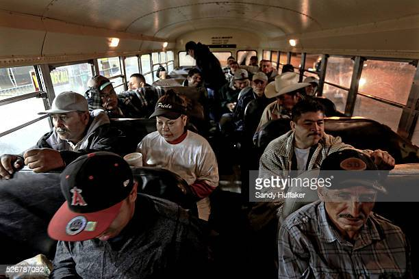 Mexican Nationals wait on a Labor bus enroute to a farm in California's Imperial Valley early morning in Calexico CA on Wednesday March 5 2014 Lines...