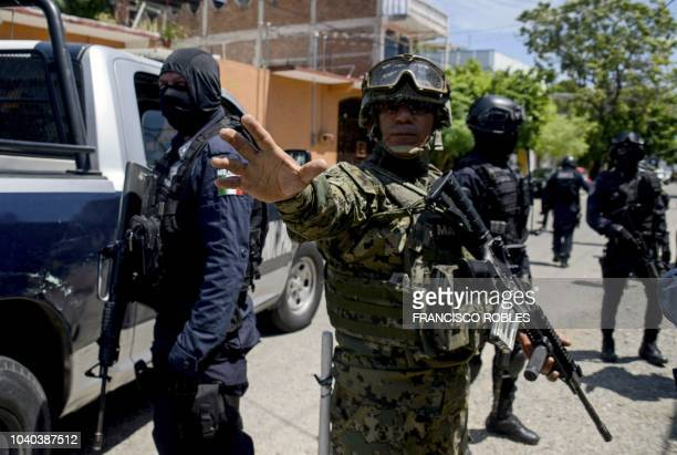 Mexican Navy members and Federal policemen take part in an operation in Acapulco state of Guerrero Mexico on September 25 2018 Mexican military...