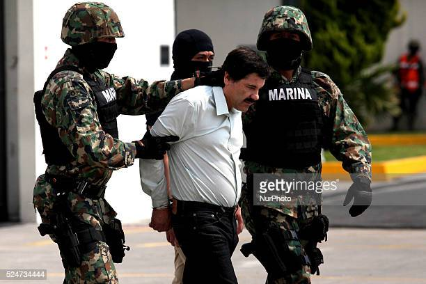 Mexican Navy soldiers escort Joaquin Guzman Loera alias El Chapo Guzman leader of the Sinaloa Cartel during his show up in front of the press at the...
