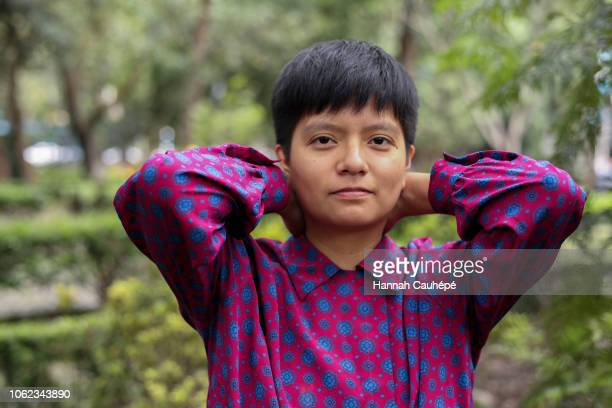 portrait of a hispanic person in mexico - non binary gender stock pictures, royalty-free photos & images