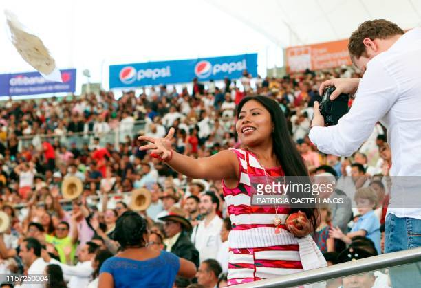 Mexican Oscarnominated actress Yalitza Aparicio attends the Guelaguetza Festival as a special guest in Oaxaca Mexico on July 22 2019 The annual...