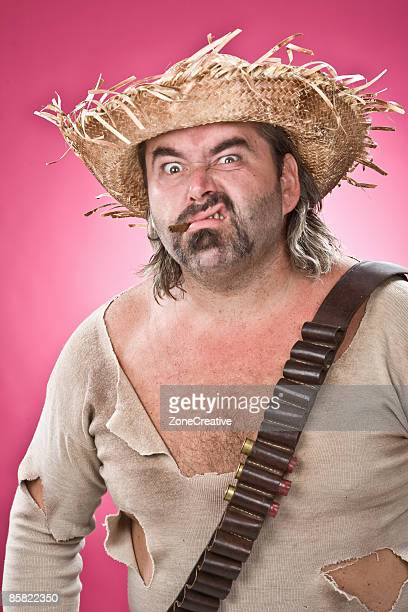 Mexican outlaw man character portrait on pink