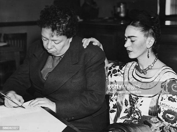 Mexican painters and spouses Diego Rivera and Frida Kahlo Rivera pictured applying for a new marriage license following their previous divorce San...
