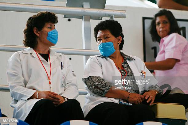 Mexican people wear face masks on the street to prevent the swine flu on April 24 2009 in Mexico City Mexico