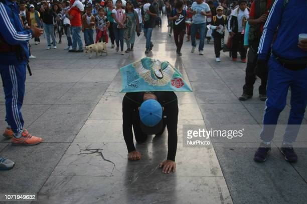 A Mexican pilgrim walks on his knees during the annual celebrations held at the Basilica of Guadalupe in Mexico City on December 11 2018 Mexicans...