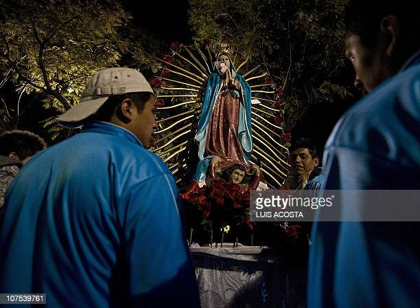 Mexican pilgrims carry an image of Our Lady of Guadalupe Mexico's patron saint outside the Basilica of Guadalupe in Mexico City during the annual...