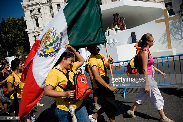 Mexican pilgrims walk past the main stage at the Cibeles Square during the preaparations ahead the visit of Pope Benedit XVI during the World Youth...