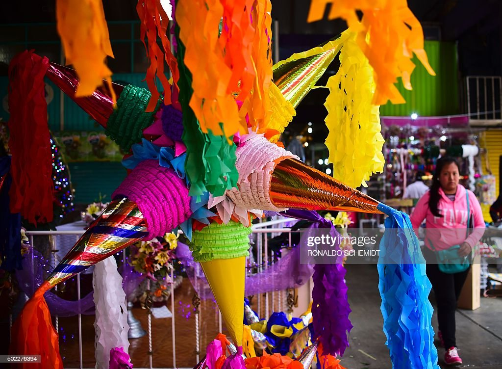 Mexican 'pinatas' for sale on display at the Jamaica market in Mexico City, on December 22, 2015. The 'piñata', a container hung during Christmas festivities and struck with a stick to release the candy inside, is used in Latin American countries for different festivities. It was introduced to Mexico in 1587 with Spanish evangelization.