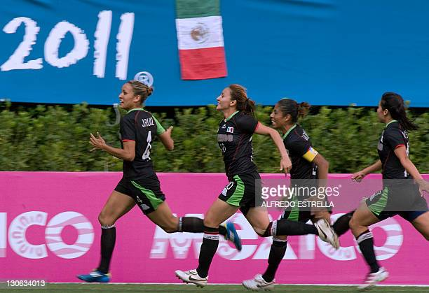 Mexican player Jennifer Ruiz celebrates with teammates after scoring against Colombia in the women's third place match at the Guadalajara 2011 XVI...