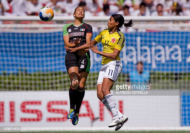 Mexican player Jennifer Ruiz vies for the ball with Colombian player Kena Romero in their women´s football match for the third place during the XVI...