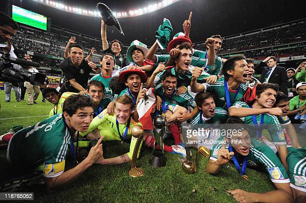 Mexican players celebrate winning the FIFA U-17 World Cup during the FIFA U-17 World Cup Mexico 2011 Final match between Uruguay and Mexico at the...