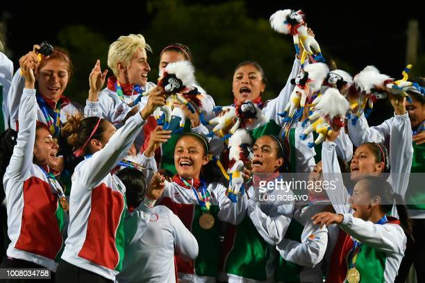Mexican players celebrate with their gold medals on the podium after winning the women's football final of the 2018 Central American and Caribbean...