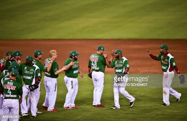 Mexican players of Aguilas de Mexicali celebrate their victory against Criollos de Caguas from Puerto Rico during the Caribbean Baseball Series at...