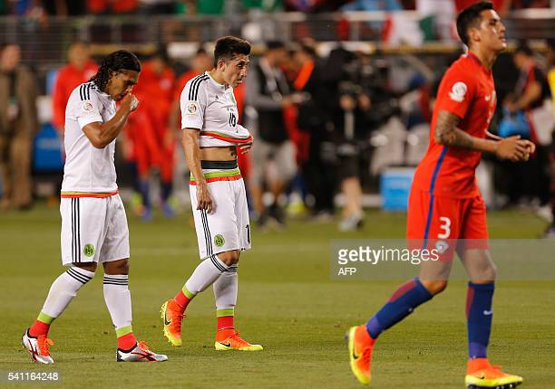 Mexican players react in dejection after a Copa America Centenario quarterfinal football match against Chile in Santa Clara California United States...
