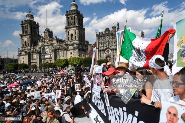 Mexican poet and activist Javier Sicilia speaks during a gathering after a march for peace at Zocalo square in Mexico City on January 26 2020 The...