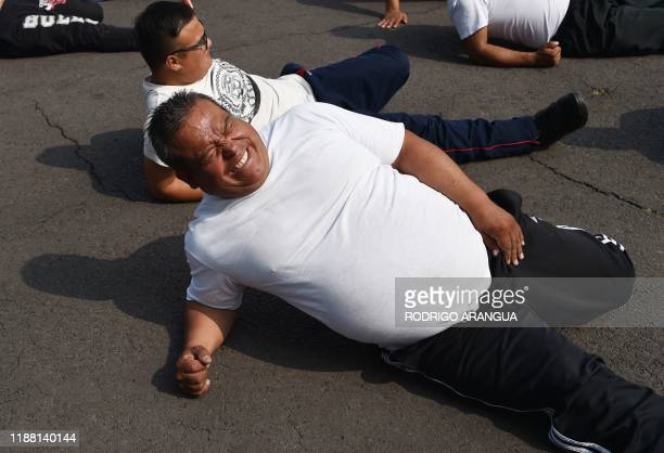 Mexican police officers excercise at a police unit in Mexico City on December 11, 2019. - 1,000 Mexico City police officers have joined a program to...